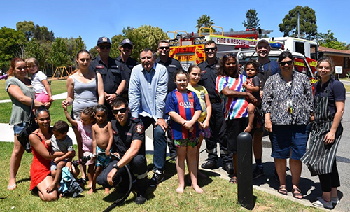 Bike workshop participants with Communities staff and firefighters